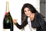 Miss India, Vasuki Sunkavalli, signing Moet bottle at Peace Market 2012