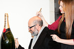 David Cross and Amber Tamblyn signing Moet bottle at Peace Market 2012