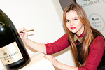 Amber Tamblyn signing Moet bottle at Peace Market 2012